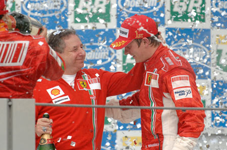 Kimi Raikkonen on the podium with Jean Todt